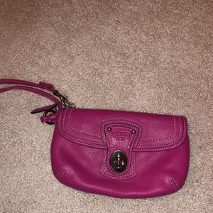 Pink Coach wristlet with lots of storage!